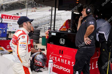 Stock Picture of Marco Andretti, talks with his father and car owner Michael Andretti during practice for the Indianapolis 500 auto race at Indianapolis Motor Speedway in Indianapolis