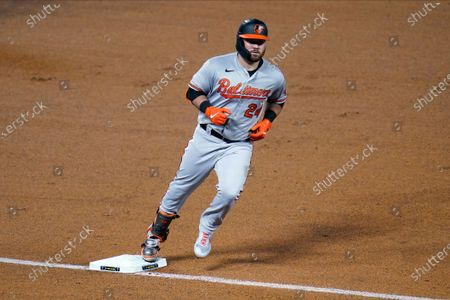 Baltimore Orioles' DJ Stewart (24) rounds third base on a two-run home run off Minnesota Twins' relief pitcher Jorge Alcala in the eighth inning of a baseball game, in Minneapolis