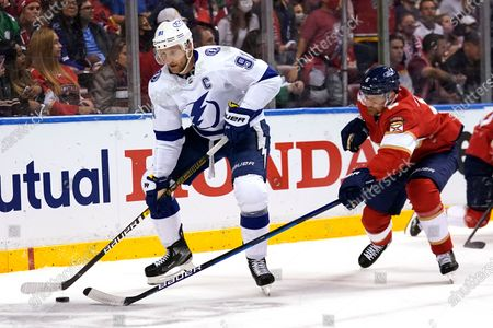 Stock Picture of Tampa Bay Lightning center Steven Stamkos (91) skates with the puck as Florida Panthers defenseman Anton Stralman (6) gives chase during the first period in Game 5 of an NHL hockey Stanley Cup first-round playoff series, in Sunrise, Fla