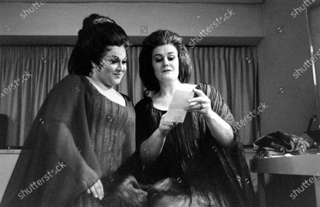 Joan Sutherland and Marilyn Horne looking at the paper at Metropolitan Opera, New York City, New York, 1970.