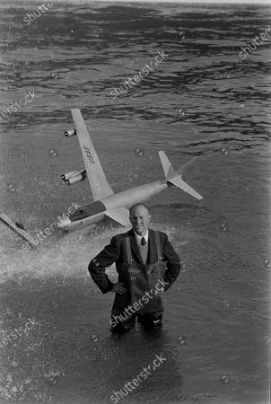 John Fulton standing near a model plane, California, United States, March 1956.