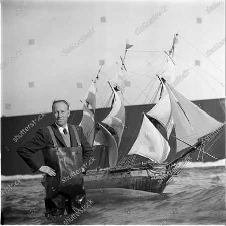 Director John Fulton, setting a sailing ship scene on set in a movie studio, California, United States, March 1956.