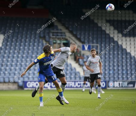 Charlie Barker of Charlton Athletic battles for possession with Ethan Chislett of AFC Wimbledon during the EFL Trophy match between AFC Wimbledon and Charlton Athletic at The Kiyan Prince Foundation Stadium, London, England, on September 1, 2020.