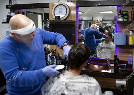 A man getting his hair cut at Mr Snips Barber Shop. Barbers' Shops and Hairdressers reopen across England after being closed since March due to the Lockdown imposed by the UK Government to help curb the spread of the COVID-19 pandemic In Stanford Le Hope, England on July 4, 2020.