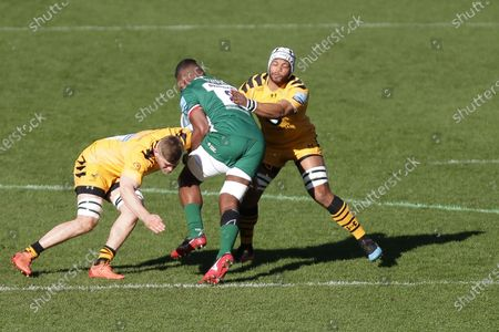 Stock Picture of Jack Willis of Wasps Rugby and Nizaam Carr of Wasps Rugby tackling Albert Tuisue of London Irish   during the Gallagher Premiership match between London Irish and London Wasps at the Madejski Stadium, Reading on Sunday 1st March 2020.