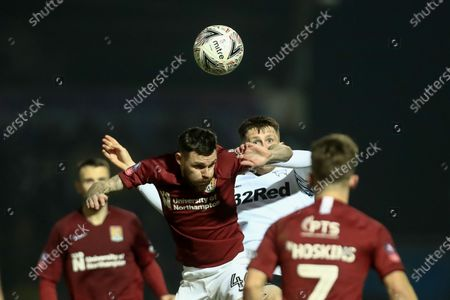 Paul Anderson of Northampton Town wins the head challenge   during the FA Cup Fourth Round match between Northampton Town and Derby County at the PTS Academy Stadium, Northampton on Friday 24th January 2020.
