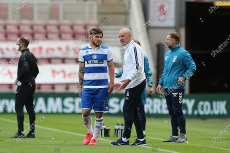 MIDDLESBROUGH, ENGLAND.Queens Park Rangers manager Mark Warburton gives instructions to Ryan Manning during the Sky Bet Championship match between Middlesbrough and Queens Park Rangers at the Riverside Stadium, Middlesbrough, England on  July 5, 2020.