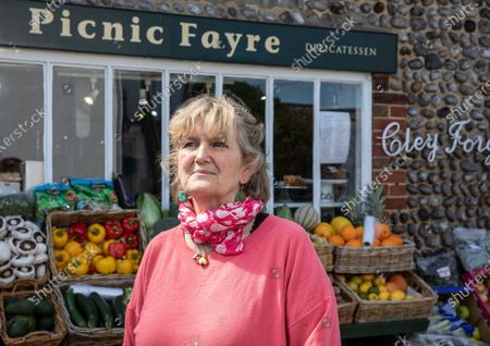 Victoria Pryor (daughter of Margaret Rhodes, the Queen's cousin), goddaughter of HRM Queen Elizabeth II, photographed outside her deli  'Picnic Fayre' in Cley Next The Sea