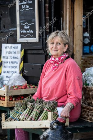 Stock Photo of Victoria Pryor (daughter of Margaret Rhodes, the Queen's cousin), goddaughter of HRM Queen Elizabeth II, photographed outside her deli  'Picnic Fayre' in Cley Next The Sea