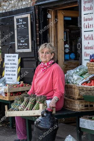 Stock Picture of Victoria Pryor (daughter of Margaret Rhodes, the Queen's cousin), goddaughter of HRM Queen Elizabeth II, photographed outside her deli  'Picnic Fayre' in Cley Next The Sea
