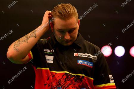Dimitri Van den Bergh composes himself during the match against James Wade; Marshall Arena, Milton Keynes, Buckinghamshire, England; Professional Darts Corporation, Unibet Premier League Night 15 Milton Keynes.