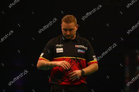 Stock Picture of Dimitri Van den Bergh composes himself during the match against James Wade; Marshall Arena, Milton Keynes, Buckinghamshire, England; Professional Darts Corporation, Unibet Premier League Night 15 Milton Keynes.