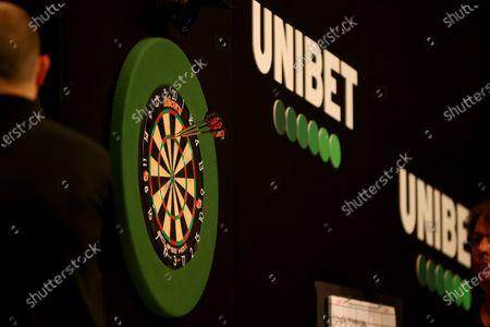 Dimitri Van den Bergh throws a 180 against James Wade; Marshall Arena, Milton Keynes, Buckinghamshire, England; Professional Darts Corporation, Unibet Premier League Night 15 Milton Keynes.