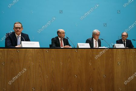 (L-R) Berlin Governing Mayor Michael Mueller, Vonovia Chief Executive Officer Rolf Buch, Berlin State Minister of Finance Matthias Kollatz-Ahnen and Deutsche Wohnen Chief Executive Officer Michael Zahn sit next to each other during a press conference at the Red Town Hall in Berlin, Germany, 25 May 2021. Berlin Senate and the heads of housing companies Vonovia and Deutsche Wohnen gave a joint press conference in order to comment on plans of Vonovia to take over the Deutsche Wohnen. On 24 May 2021, Vonovia has announced its intention to acquire all Deutsche Wohnen shares in a voluntary public takeover offer to Deutsche Wohnen shareholders.