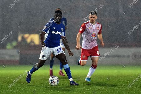 Christopher Missilou of Oldham Athletic and Jason Cowley of Stevenage during the Sky Bet League 2 match between Stevenage and Oldham Athletic at the Lamex Stadium, Stevenage on Tuesday 14th January 2020.