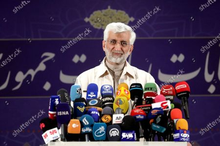 Former top nuclear negotiator Saeed Jalili speaks to journalists after registering his candidacy for the upcoming presidential elections at the Interior Ministry in Tehran, Iran, . Iran named seven candidates Tuesday, May 15, for its June 18 presidential election, approving the candidacy of Jalili and hard-line cleric Ebrahim Raisi, while barring former parliament speaker Ali Larijani allied to the country's current president