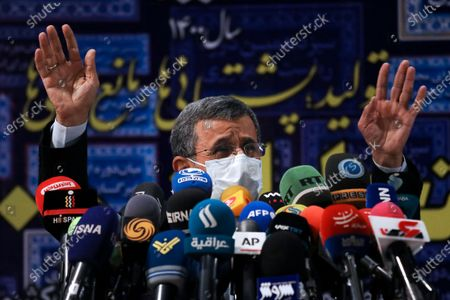 Former President Mahmoud Ahmadinejad waves to media at the conclusion of his press briefing after registering his name as a candidate for the upcoming presidential elections, at the Interior Ministry in Tehran, Iran, . Iran named seven candidates Tuesday, May 15, for its June 18 presidential election, approving the candidacy of hard-line cleric Ebrahim Raisi, while barring former parliament speaker Ali Larijani and Ahmadinejad