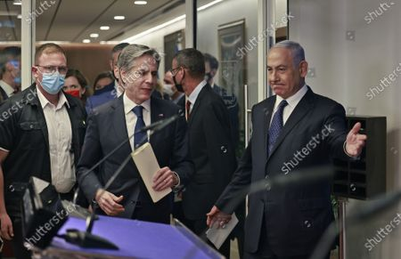 Israeli Prime Minister Benjamin Netanyahu (R) and U.S. Secretary of State Tony Blinken arrive for a joint press conference in Jerusalem on May 25, 2021, days after an Egypt-brokered truce halted fighting between the Jewish state and the Gaza Strip's rulers Hamas.