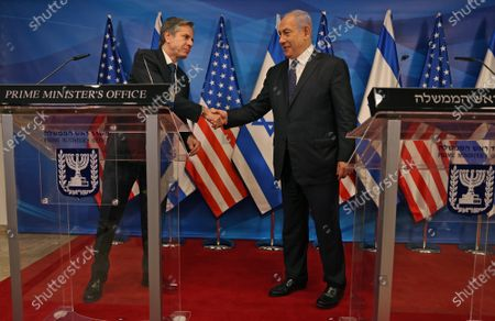 Israeli Prime Minister Benjamin Netanyahu (R) and U.S. Secretary of State Tony Blinken shake hands during a joint press conference in Jerusalem on May 25, 2021, days after an Egypt-brokered truce halted fighting between the Jewish state and the Gaza Strip's rulers Hamas.