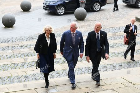 Prince Charles and Camilla Duchess of Cornwall are accompanied by Lord-Lieutenant of the West Midlands, John Crabtree (R) on their arrival for a visit to Coventry Cathedral in Coventry, central England on May 25, 2021, during the 59th anniversary of its Consecration year.