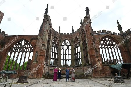 Stock Picture of Prince Charles (2R) and Camilla Duchess of Cornwall are accompanied by the Bishop of Coventry, Rev Christopher Cocksworth (L) and the Dean of Coventry Rev John Witcombe (R) as they look at the ruins of the Old Cathedral during their visit to Coventry Cathedral in Coventry, central England on May 25, 2021, during the 59th anniversary of its Consecration year.