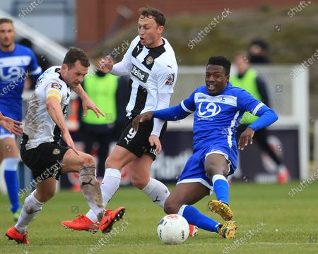 Timi Odusina of Hartlepool United in action with Michael Doyle and Kristian Dennis of Notts County during the Vanarama National League match between Hartlepool United and Notts County at Victoria Park, Hartlepool on Saturday 22nd February 2020.