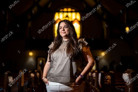 Kelly Sherman-Conroy, a Lakota Lutheran Minister, poses for a portrait at the Lutheran Church of the Redeemer before the start of a National Interfaith Service for Peace on Sunday, May 23, 2021 in St. Paul, MN. (Kent Nishimura / Los Angeles Times)