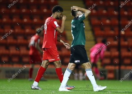 Scott Wootton of Plymouth Argyle looking dejected  during the Carabao Cup match between Leyton Orient and Plymouth Argyle at the Matchroom Stadium, London, England.