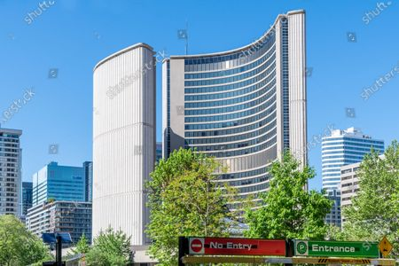 Unusual angle of the New City Hall towers in the Nathan Phillips Square in the Toronto downtown, Canada