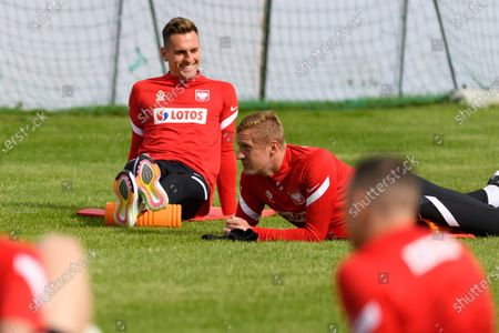 Arkadiusz Milik (L) and Kamil Glik (R) during a training session of the Polish national team in Opalenica, Poland, 25 May 2021. Poland is preparing for the UEFA EURO 2020 tournament and will face Spain, Sweden and Slovakia in their Group E stage.