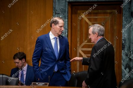 United States Senator Ron Wyden (Democrat of Oregon), left, talks with United States Senator Mike Crapo (Republican of Idaho) prior to a Senate Committee on Finance nominations hearing, in the Dirksen Senate Office Building in Washington, DC,.