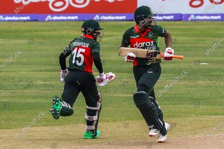 Bangladesh's Mushfiqur Rahim and  Mohammad Mahmudullah run between the wickets during the second one-day international (ODI) cricket match between Bangladesh and Sri Lanka at the Sher-e-Bangla National Cricket Stadium in Dhaka on May 25, 2021.
