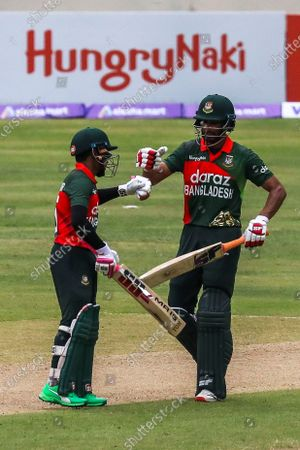 Stock Picture of Bangladesh's Mushfiqur Rahim celebrates after scoring a half-century (50 runs) with teammate Mohammad Mahmudullah during the second one-day international (ODI) cricket match between Bangladesh and Sri Lanka at the Sher-e-Bangla National Cricket Stadium in Dhaka on May 25, 2021.