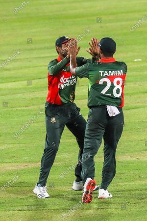 Stock Image of Bangladesh'sTamim Iqbal and Mohammad Mahmudullah celebrates after the dismissal of Sri Lanka's Dasun Shanaka during the second one-day international (ODI) cricket match between Bangladesh and Sri Lanka at the Sher-e-Bangla National Cricket Stadium in Dhaka on May 25, 2021.