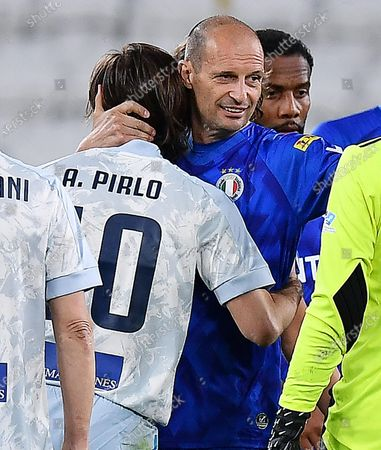 Juventus' coach Andrea Pirlo (L) and former Juventus' coach Massimiliano Allegri during the 2021 'Partita del Cuore' (Match of the Heart) charity soccer match between the 'Nazionale Cantanti' (Singers national team) and 'Campioni per la Ricerca' (Research champions) at the Allianz Stadium in Turin, Italy, 25 May 2021.