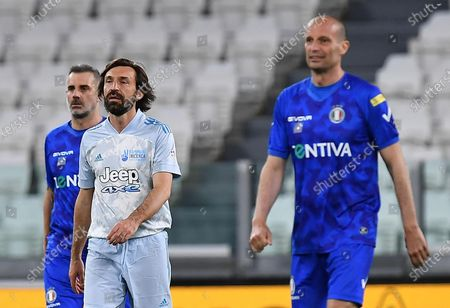 Juventus' coach Andrea Pirlo (2L) and   former Juventus' coach Massimiliano Allegri (R) during the 2021 'Partita del Cuore' (Match of the Heart) charity soccer match between the 'Nazionale Cantanti' (Singers national team) and 'Campioni per la Ricerca' (Research champions) at the Allianz Stadium in Turin, Italy, 25 May 2021.