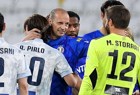 Former Juventus' coach Massimiliano Allegri (C) with Juventus' coach Andrea Pirlo and Juventus' goalkeeper Marco Storari during the 2021 'Partita del Cuore' (Match of the Heart) charity soccer match between the 'Nazionale Cantanti' (Singers national team) and 'Campioni per la Ricerca' (Research champions) at the Allianz Stadium in Turin, Italy, 25 May 2021.