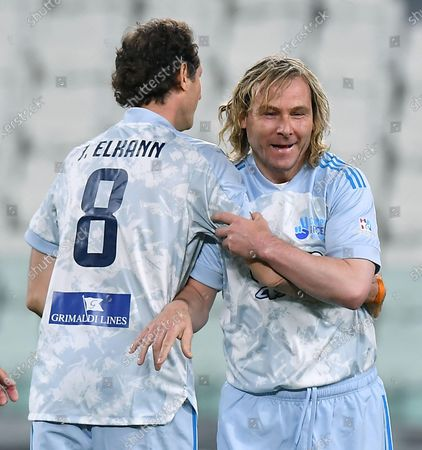 Stock Image of Exor chairman and Ceo John Elkann (L) and Juventus' vice president Pavel Nedved during the 2021 'Partita del Cuore' (Match of the Heart) charity soccer match between the 'Nazionale Cantanti' (Singers national team) and 'Campioni per la Ricerca' (Research champions) at the Allianz Stadium in Turin, Italy, 25 May 2021.