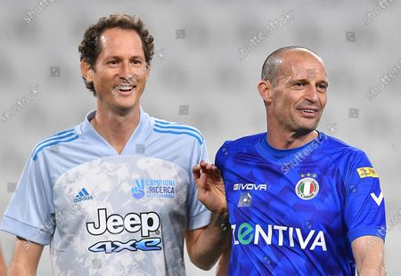 Former Juventus' coach Massimiliano Allegri (R) and  Exor chairman and Ceo John Elkann during the 2021 'Partita del Cuore' (Match of the Heart) charity soccer match between the 'Nazionale Cantanti' (Singers national team) and 'Campioni per la Ricerca' (Research champions) at the Allianz Stadium in Turin, Italy, 25 May 2021.