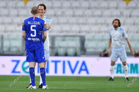 Former Juventus' coach Massimiliano Allegri(L); Exor chairman and Ceo John Elkann and Juventus' coach Andrea Pirlo (R) during the 2021 'Partita del Cuore' (Match of the Heart) charity soccer match between the 'Nazionale Cantanti' (Singers national team) and 'Campioni per la Ricerca' (Research champions) at the Allianz Stadium in Turin, Italy, 25 May 2021.