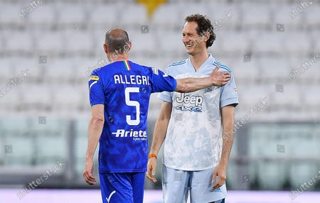 Former Juventus' coach Massimiliano Allegri (L) and  Exor chairman and Ceo John Elkann during the 2021 'Partita del Cuore' (Match of the Heart) charity soccer match between the 'Nazionale Cantanti' (Singers national team) and 'Campioni per la Ricerca' (Research champions) at the Allianz Stadium in Turin, Italy, 25 May 2021.