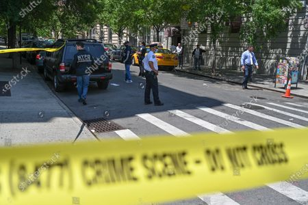 Crime scene tape at the scene of a daytime shooting at Adam Clayton Powell Jr. Boulevard and 115th Street in the Harlem neighborhood of New York.