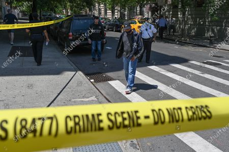 Stock Photo of Crime scene tape at the scene of a daytime shooting at Adam Clayton Powell Jr. Boulevard and 115th Street in the Harlem neighborhood of New York.