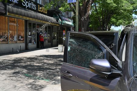 A shattered car window from a bullet at a crime scene involving a daytime shooting at Adam Clayton Powell Jr. Boulevard and 115th Street in the Harlem neighborhood of New York.