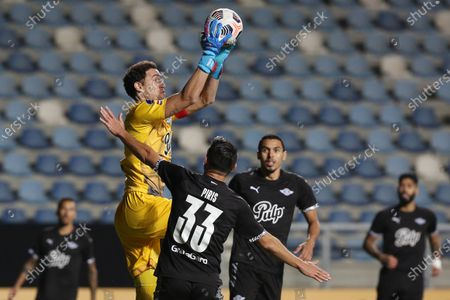 Stock Picture of Martin Silva (top) goalkeeper of Libertad in action during the Copa Sudamericana soccer match between Palestino and Libertad at El Teniente stadium in Rancagua, Chile, 25 May 2021.