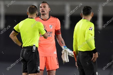Stock Picture of River Plate's goalkeeper Franco Armani argues with the Uruguayan referee Esteban Ostojich (L), during the end of the first half of the Copa Libertadores group D soccer match between  River Plate and Fluminense at the Monumental de Nunez Stadium, in Buenos Aires, Argentina, 25 May 2021.