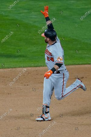 Baltimore Orioles' DJ Stewart (24) rounds the bases on a solo home run off Minnesota Twins' relief pitcher Alex Colome in the eighth inning of a baseball game, in Minneapolis. The Twins won 7-4