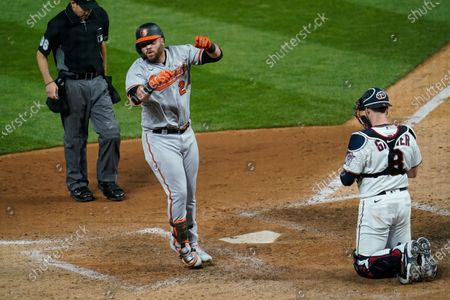 Baltimore Orioles' DJ Stewart (24) scores on a solo home run off Minnesota Twins' relief pitcher Alex Colome in the eighth inning of a baseball game, in Minneapolis. The Twins won 7-4