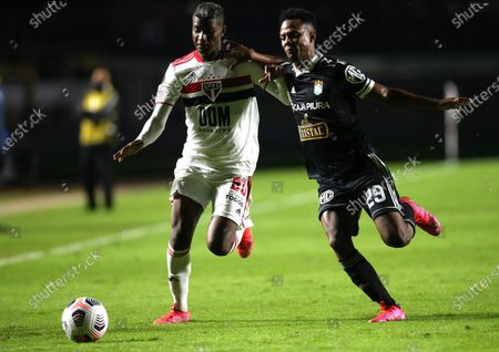 Stock Photo of Luis Orejuela (L) of Sao Paulo vies for the ball with Nilson Loyola of Sporting during the Copa Libertadores group E soccer match between Sao Paulo and Sporting Cristal at Morumbi Stadium in Sao Paulo, Brazil, 25 May 2021.