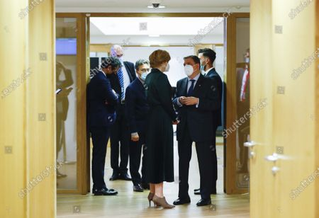 Germany's Minister of Food and Agriculture Julia Klockner, center, speaks with Spain's Minister for Agriculture Luis Planas during a meeting of EU Agriculture Ministers at the European Council building in Brussels